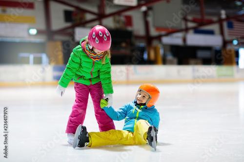 Fotografie, Obraz Child skating on indoor ice rink. Kids skate.