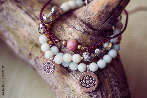 Fotografía Three natural mineral stone beads bracelet on wooden background