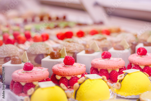 Canvas Print Beautiful delicious pastries with raspberry on a showcase in a French shop