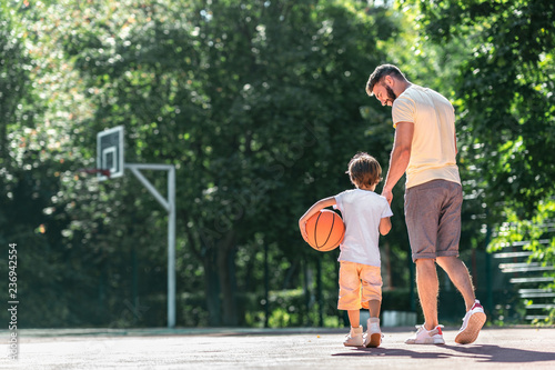 Young family on the basketball court