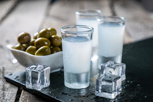 Fotografia Traditional greek vodka - ouzo in shot glasses