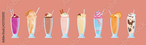 Photo Collection of delicious milkshakes in glasses with straws