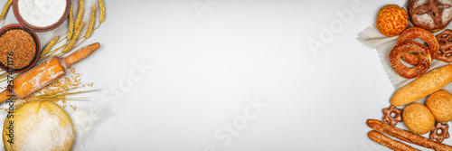 Fresh bakery products and ingredients for his cooking, banner with space for text, top view