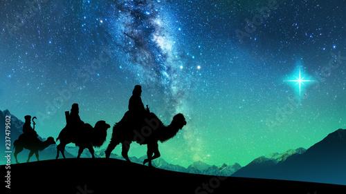 Obraz na płótnie Silhouette of Three wise men riding a camel along the star path