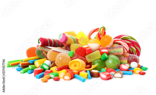 Many different yummy candies on white background