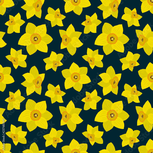 Foto Seamless pattern with yellow daffodils on a dark blue background