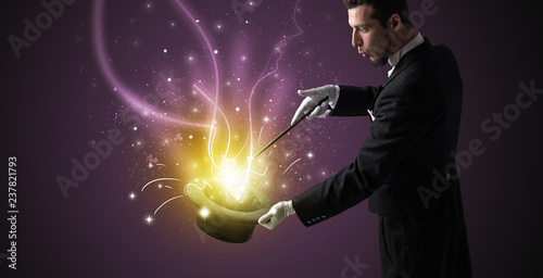 Wallpaper Mural Magician hand conjure with wand  light from a black cylinder