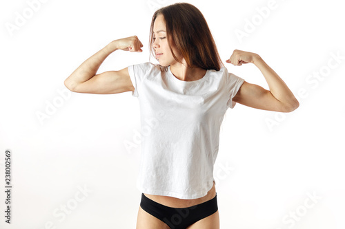 sport fitness woman showing her biceps muscles Fototapet
