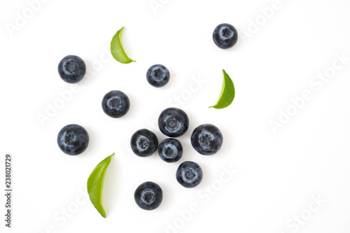Group blueberries and leaf isolated on white