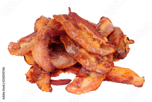 Fried smoked streaky bacon rashers isolated on a white background
