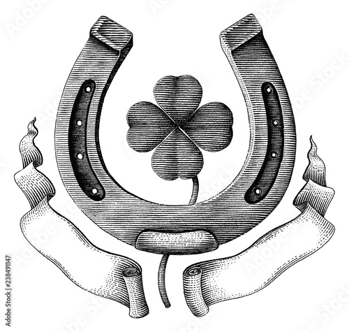 Antique of Horseshoe and clover leaf with ribbon hand draw illustration vintage engraving style isolated on white background