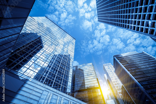 Fotografia, Obraz Commercial buildings in Hongkong are low angle, China,