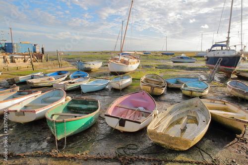 Colorful boats at low tide, located along the Thames Estuary, Leigh on Sea, UK Fototapeta
