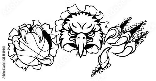 Wallpaper Mural An eagle bird basketball sports mascot cartoon character ripping through the bac