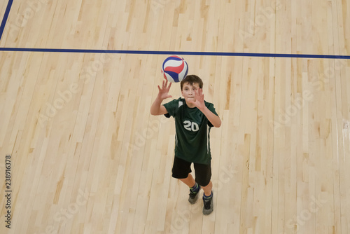 Volleyball player setting the ball
