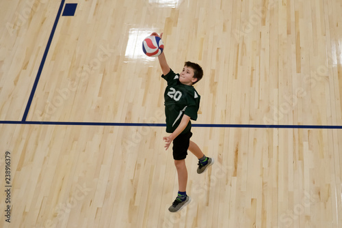 Volleyball player jumps to hit the ball