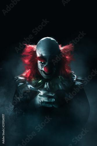 Obraz na płótnie Scary clown on a dark background