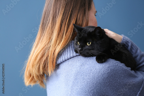 Stampa su Tela Cute black cat with owner at home