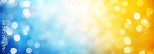 Blue and yellow circular reflections. Blured Christmas and New Year light. Winter abstract defocused background.