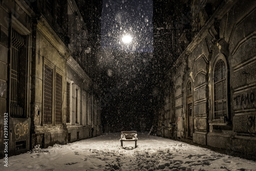 Fotografia, Obraz Empty bench on a dark alley