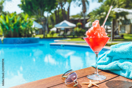 Frozen Margarita or Daiquiry cocktail near the pool. Vacation, summer, holiday, luxury resort concept. Coral shade drink