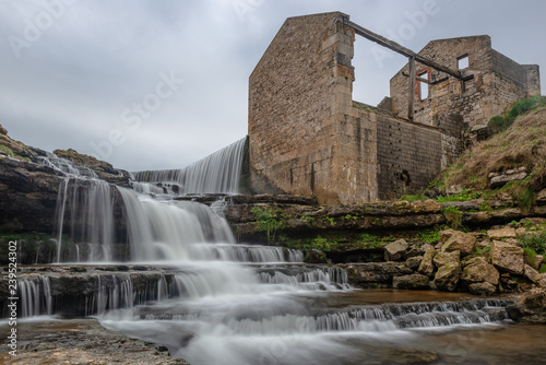 El Bolao Waterfall and a mill in ruins, Cantabria, Spain