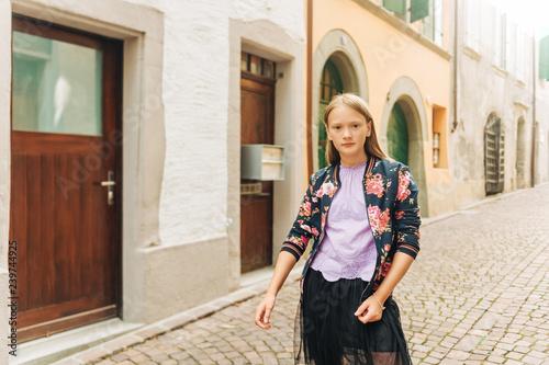 Outdoor fashion portrait of cute preteen girl, wearing black tutu skirt and fash Fototapete