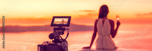 Videography professional video camera shoot behind the scene shooting at hotel filming sunset scene banner panorama, luxury travel. Professional videography equipment shooting in summer destination.
