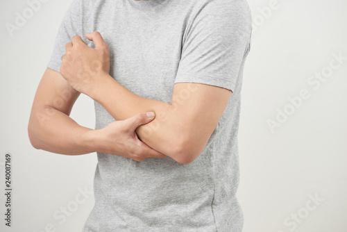 Fotografia man suffering from joint pain, arm bone pain, arthritis, gout, rheumatoid sympto