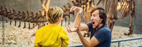 Fotografie, Obraz Dad and boy watching dinosaur skeleton in museum BANNER, LONG FORMAT
