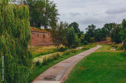 Path between trees and citadel walls, near the Citadel of Lille, France Fototapeta