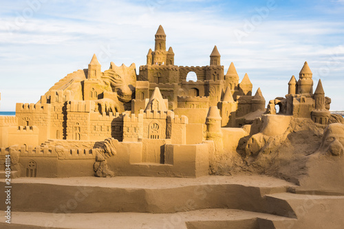 Fotografia Fantasy city made from sand against a blue sky