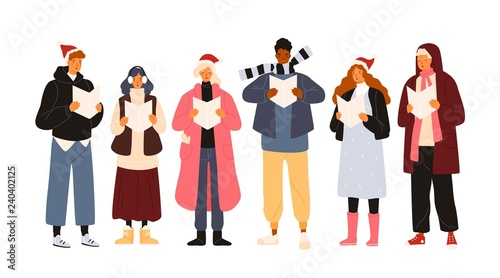 Photographie Choir or group of cute men and woman dressed in outerwear singing Christmas carol, song or hymn