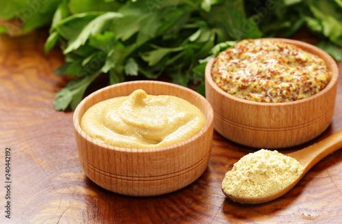 Fototapeta Natural mustard, seasoning and sauce on a wooden table