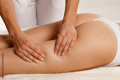 Stampa su Tela anti-cellulite massage on the legs of young women
