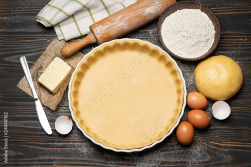shortbread dough for baking quiche tart and ingredients in baking form Fototapeta