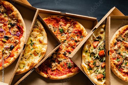 Fotografie, Obraz pizza on the black background