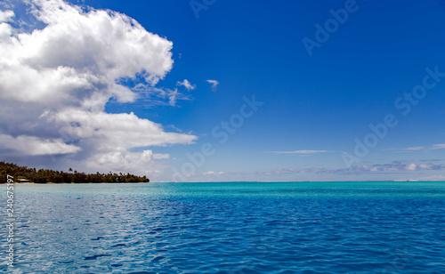 Fotografie, Obraz Beautiful blue lagoon near the island of Tahaa  in the Leeward group of the Society Islands of French Polynesia