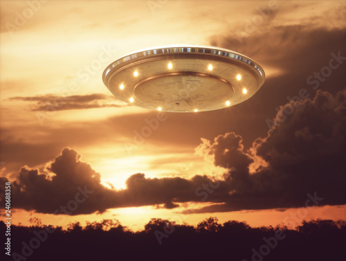 Canvas Print Unidentified flying object, UFO with the sunset in the background