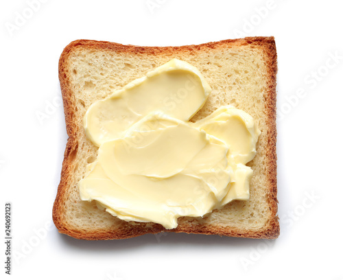 Tasty toast with butter isolated on white, top view