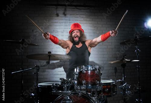 Billede på lærred The drummer in the red cylinder