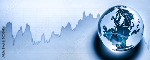 Fotografie, Tablou Crystal Earth On Stock market Graph - Global Economy Concept