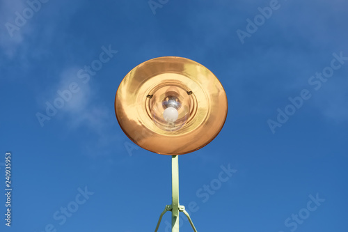 Copper large light shade lantern from victorian times retro style against blue s Fototapeta