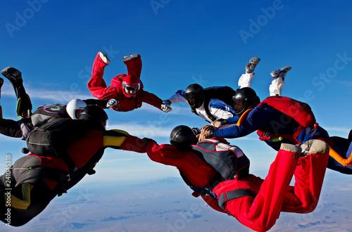 Skydiving teamwork formation make a circle