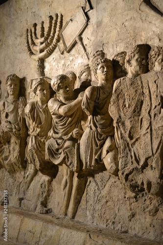 Wall relief on arch of titus depicting Menorah taken from temple in Jerusalem in Fototapeta