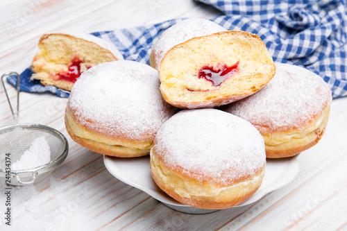 Traditional Polish donuts on wooden background Fototapeta