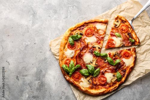 Obraz na plátně Delicious pizza on grey background
