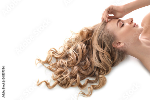 Stampa su Tela Young woman with beautiful curly hair on white background