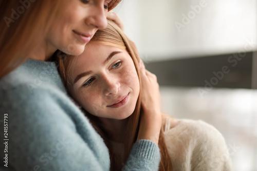 Fototapeta Portrait of happy mother with daughter