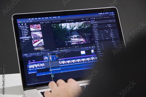 Obraz na plátně Video editing with laptop